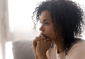 Close up of pensive black woman thinking having life troubles